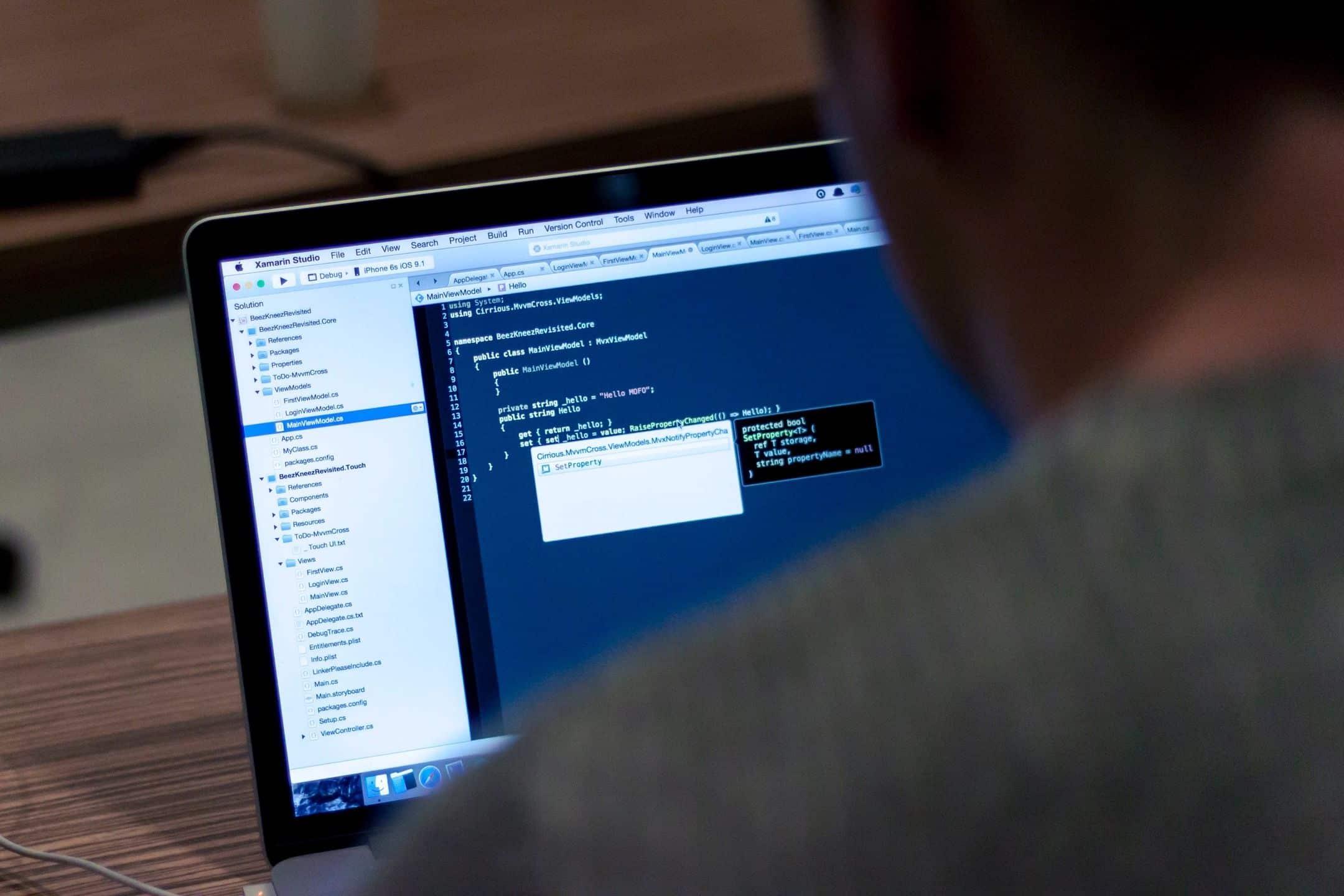 Man coding a web site design